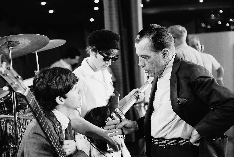 Host Ed Sullivan speaks with Paul McCartney while John Lennon tunes his guitar. Photo: Bob Gomel, Time & Life Pictures/Getty Image / Time Life Pictures