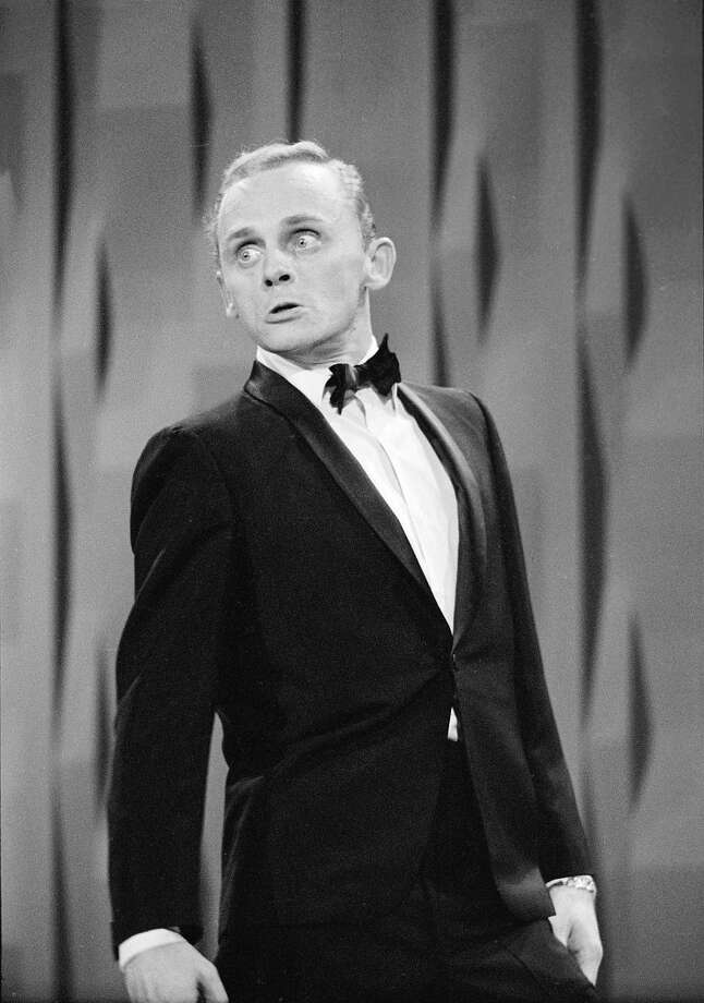 """American actor and impressionist Frank Gorshin performs on """"The Ed Sullivan Show"""" the same night. Many may recognize Gorshin as the Riddler in the Batman television series. Photo: CBS Photo Archive, Getty Images / 2005 CBS WORLDWIDE INC."""