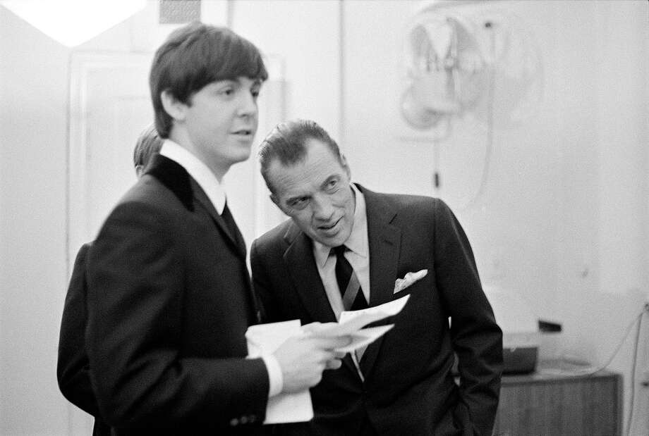 Paul McCartney talks to Ed Sullivan backstage. Photo: CBS Photo Archive, CBS Via Getty Images / 1964 CBS Photo Archive
