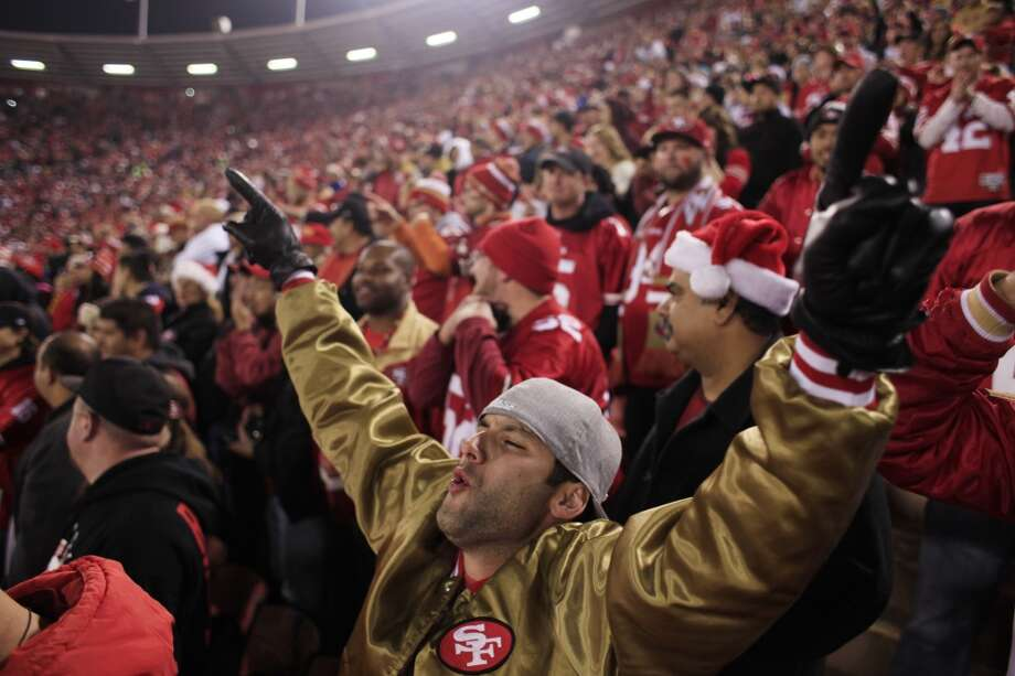 On the final regular season game and potentially the last football game at Candlestick Park, Evan McDonald of San Diego throws his hands up in a moment of glory as the 49ers score a touchdown in the final minutes of the game against the Atalanta Falcons on Monday Dec. 23, 2013 in San Francisco Calif. Photo: Mike Kepka, The Chronicle