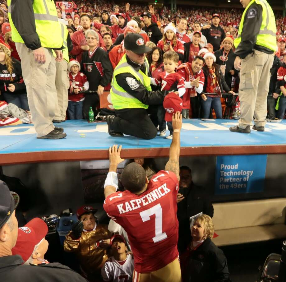 San Francisco 49ers quarterback Colin Kaepernick (7) hands his cap to a young fan after the 49ers defeated the Atlanta Falcons 34-24 at Candlestick Park on Monday, Dec. 23, 2013 in San Francisco, Calif. Photo: For The Chronicle