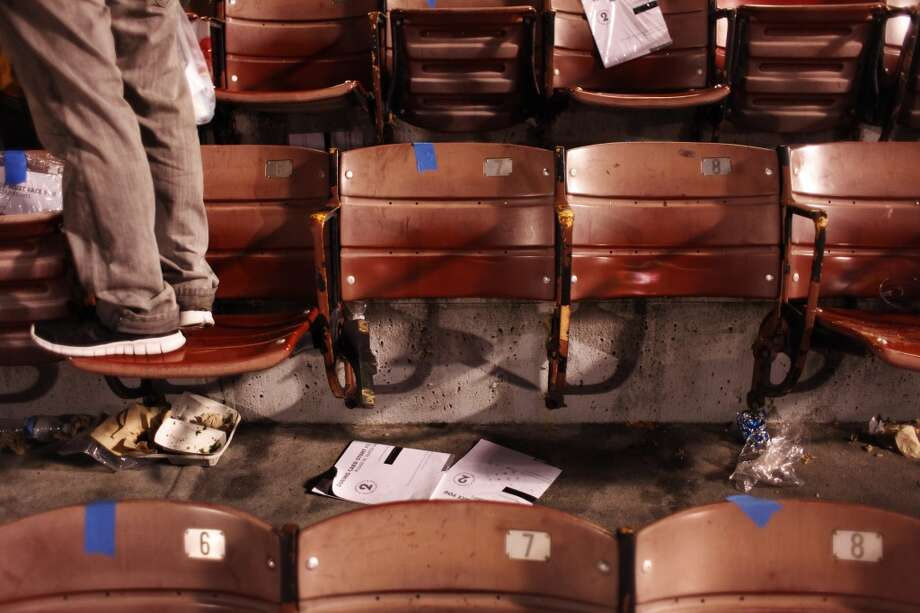 A fan stands next to two seats that were dismantled for souvenirs after a 49ers game against the Atlanta Falcons at Candlestick Park on December 23, 2013 in San Francisco, Calif. This will be the last regular-season game at Candlestick Park. Photo: The Chronicle