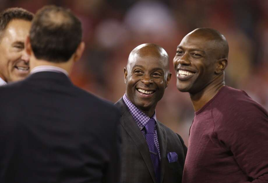 Former San Francisco 49ers wide receiver Jerry Rice, center, is joined on the field by former San Francisco 49ers wide receiver Terrell Owens, right, for a ceremony after the game between the San Francisco 49ers and Atlanta Falcons at Candlestick Park on Monday December 23, 2013 in San Francisco, Calif.  The 49ers defeated the Falcons, 34-24, in the last home game the 49ers will have at Candlestick Park before the stadium is demolished. Photo: Michael Macor, The Chronicle