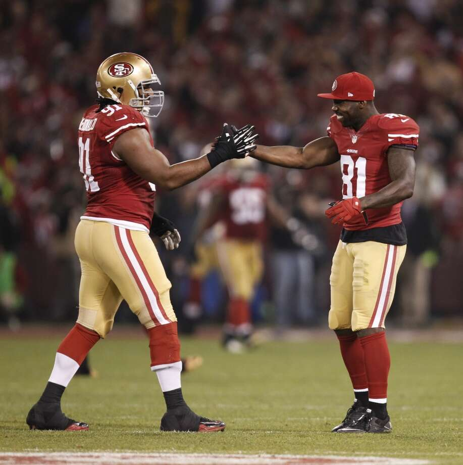 San Francisco 49ers wide receiver Anquan Boldin (81), right, and San Francisco 49ers defensive tackle Ray McDonald (91) congratulate each other after San Francisco 49ers linebacker NaVorro Bowman (53), not pictured, returned an interception eighty-nine yards for a touchdown during the fourth quarter of the game between the San Francisco 49ers and Atlanta Falcons at Candlestick Park on Monday December 23, 2013 in San Francisco, Calif. Photo: Michael Macor, The Chronicle
