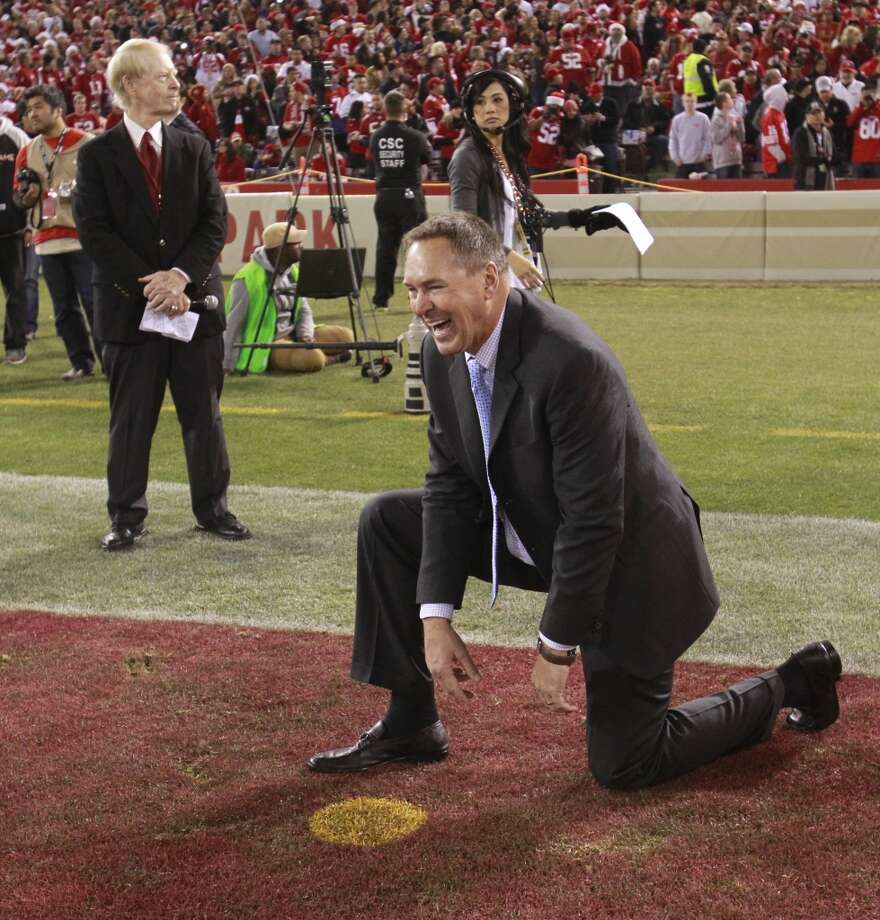 "Former 49er Dwight Clark kneels over the spot in the end zone, on Monday, Dec. 23, 2013 in San Francisco, Calif., where he caught ""The Catch"" at Candlestick Park to win the NFC Championship game against the Dallas Cowboys in 1982. Photo: Beck Diefenbach, For The Chronicle"