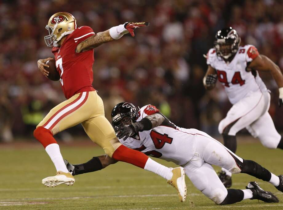 San Francisco 49ers quarterback Colin Kaepernick (7) tries to get away from Atlanta Falcons outside linebacker Stephen Nicholas (54) and defensive tackle Peria Jerry (94) during the first quarter at Candlestick Park on Monday, Dec. 23, 2013 in San Francisco, Calif. Photo: Beck Diefenbach, For The Chronicle