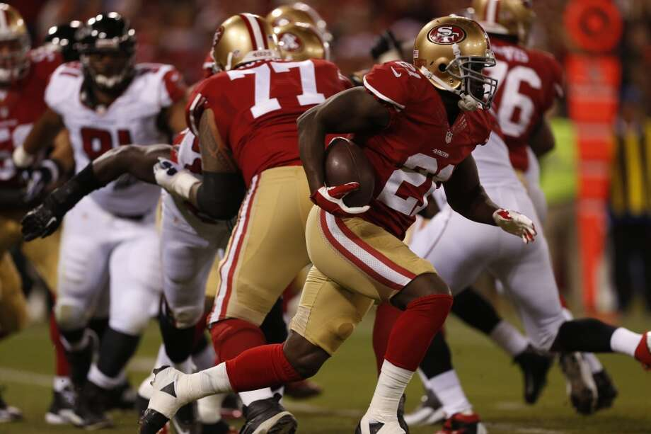 San Francisco 49ers running back Frank Gore (21) picks up yardage in the first quarter of Monday night's game against the Atlanta Falcons on Dec. 23, 2013 in San Francisco, Calif. Photo: Beck Diefenbach, For The Chronicle