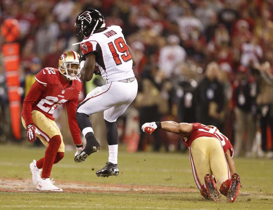 Atlanta Falcons wide receiver Drew Davis (19) spins away from San Francisco 49ers cornerback Carlos Rogers (22) and safety Eric Reid (35) during the 2nd quarter on Dec. 23, 2013 in San Francisco, Calif. Photo: Beck Diefenbach, For The Chronicle