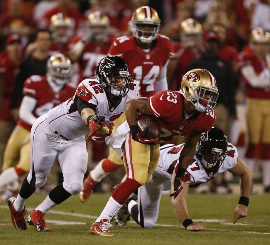 San Francisco 49ers running back LaMichael James (23) returns at first quarter punt for 10 yards chased by Atlanta Falcons fullback Patrick DiMarco (42) and Josh Harris on Monday, Dec. 23, 2013 at Candlestick Park in San Francisco, Calif. Photo: Beck Diefenbach, For The Chronicle