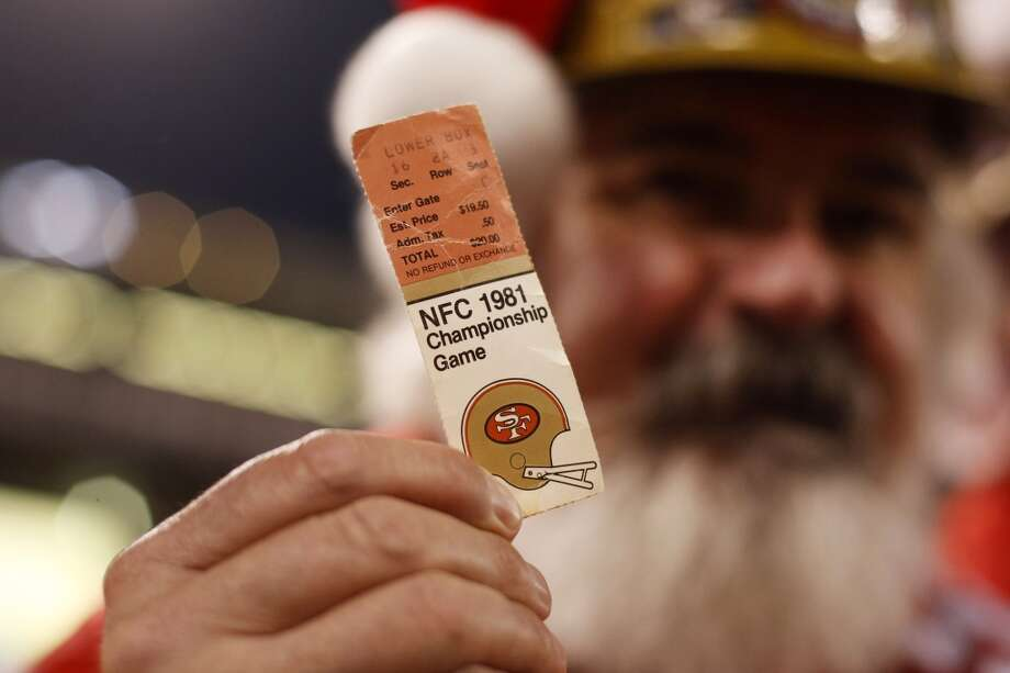 Pat Ryan displays his ticket from the 1981 NFC Championship Game during a 49ers game against the Atlanta Falcons at Candlestick Park on December 23, 2013 in San Francisco, Calif. Ryan said this was his 34th year attending games. This will be the last regular-season game at Candlestick Park. Photo: Pete Kiehart, The Chronicle