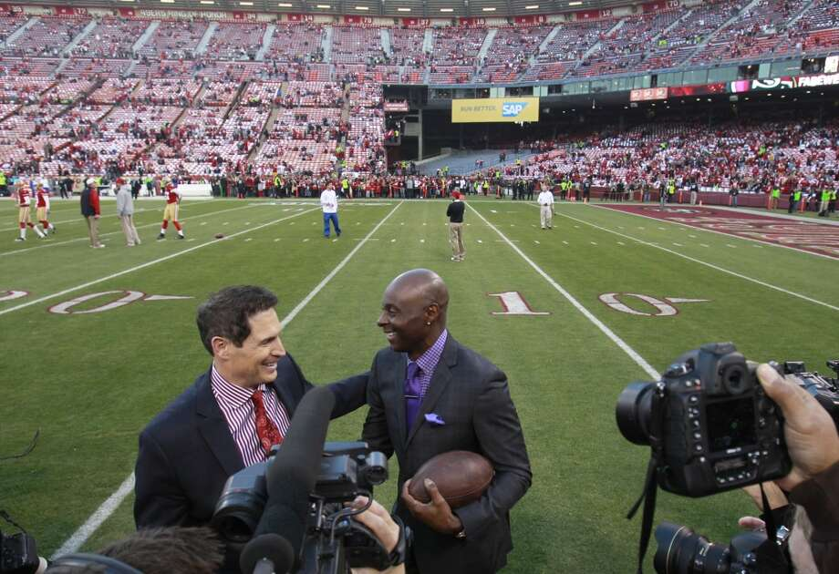 Former San Francisco 49ers players Steve Young, left, and Jerry Rice meet on the field before the game between the San Francisco 49ers and Atlanta Falcons at Candlestick Park on Monday December 23, 2013 in San Francisco, Calif. Photo: Beck Diefenbach, Special To The Chronicle