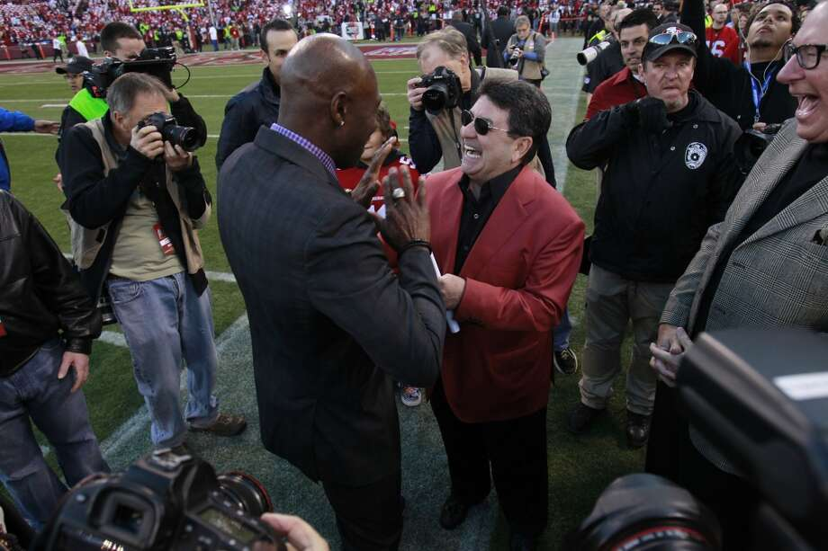 Former San Francisco 49ers wide receiver Jerry Rice talks to former San Francisco 49ers owner Edward DeBartolo before the game between the San Francisco 49ers and Atlanta Falcons at Candlestick Park on Monday December 23, 2013 in San Francisco, Calif. Photo: Beck Diefenbach, Special To The Chronicle