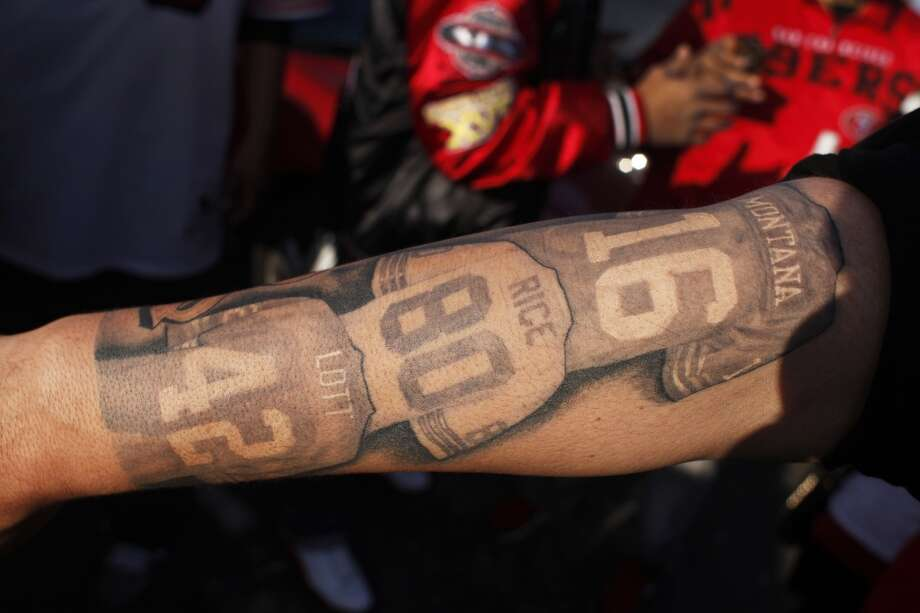 Juan Benavides displays his 49ers-themed tattoo before a 49ers game against the Atlanta Falcons at Candlestick Park on December 23, 2013 in San Francisco, Calif. This will be the last regular-season game at Candlestick Park. Photo: Pete Kiehart, The Chronicle