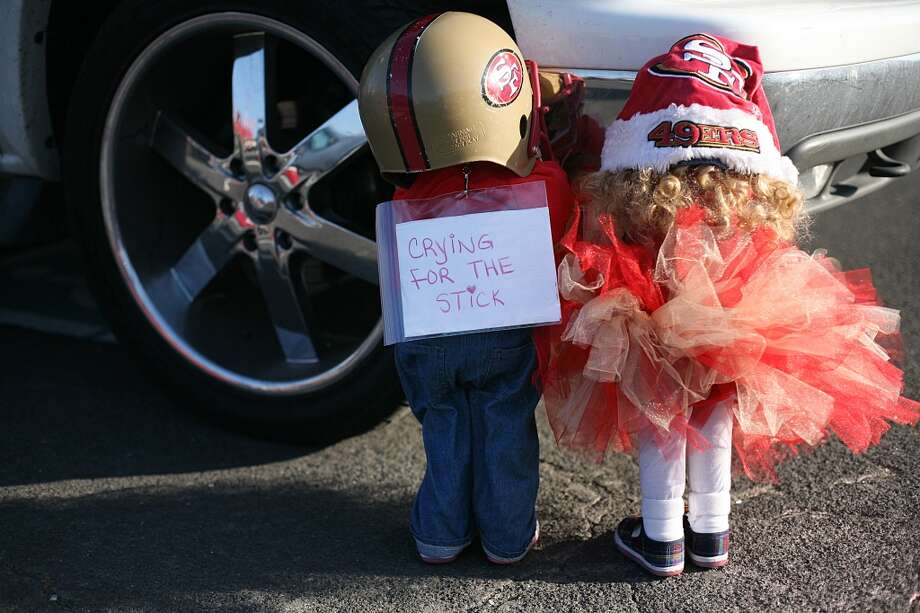 Props dressed in children's clothing are set up by a car in the parking lot of Candlestick Park on Monday, Dec. 23, 2013. The San Francisco 49ers hosted the Atlanta Falcons at one of their last games at Candlestick Park. Photo: James Tensuan, Special To The Chronicle