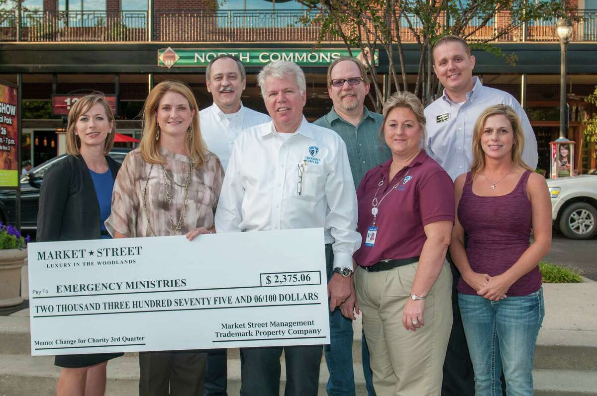 Dana Pritchard, far right, presents a check to Emergency Ministries.