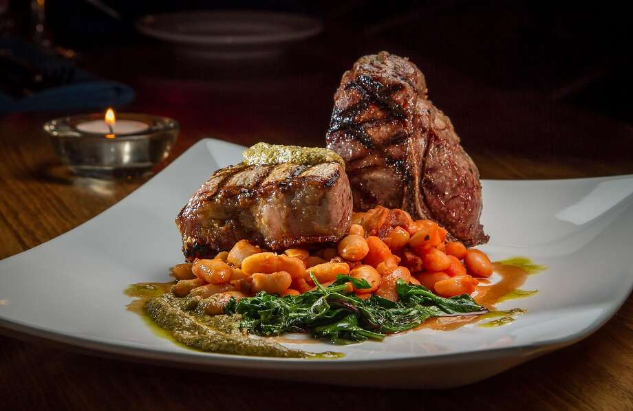 The grilled lamb T-bone chops ($20) also feature cannellini ragout, braised rainbow chard and mint pesto. Photo: John Storey, Special To The Chronicle