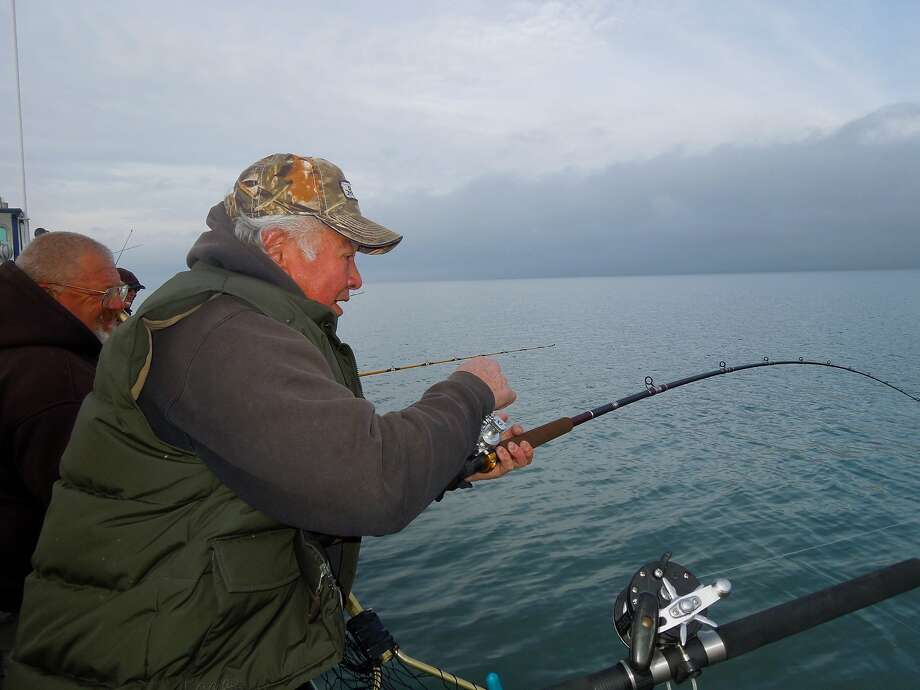 Ed King of Fremont gets a fight he didn't expect with a bat ray from a boat in San Pablo Bay. Photo: Brian Murphy