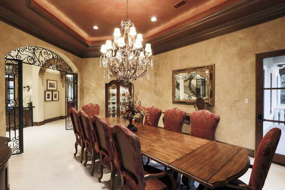 18 Netherfield Way: This 2005 estate has 5 bedrooms, 5 full and 4 half bathrooms, 10,575 square feet, and features a gourmet kitchen, wine cellar and tasting room, movie theater, pool pavilion, and golf course views. Listed for $6,250,000. Photo: Houston Association Of Realtors