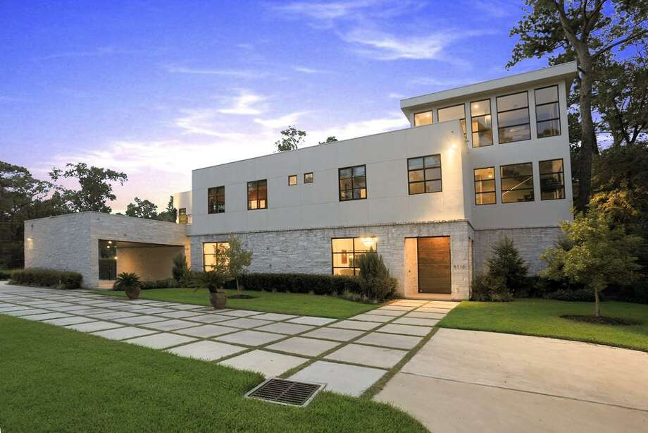 9110 Wickford: This 2009 estate has 7 bedrooms, 6 full and 2 half bathrooms, 10,211 square feet, and features a gourmet kitchen, wine cellar and tasting room, two-story master closet, gorgeous backyard, and beautiful modern style. Listed for $5,190,000. Photo: Houston Association Of Realtors