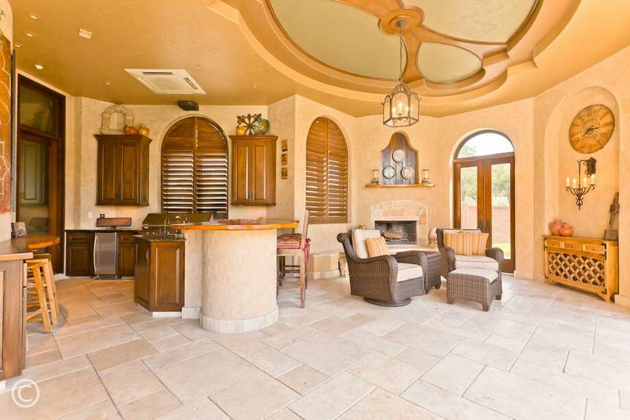 7 Grand Manor: This 2009 Mediterranean mansion has 5 bedrooms, 5 full and 3 half bathrooms, 12,957 square feet, and features a custom woodwork, two-story library, movie theater, second kitchen, fabulous outdoor entertaining area, and pool with a lazy river. Listed for $6,999,888. Photo: Houston Association Of Realtors