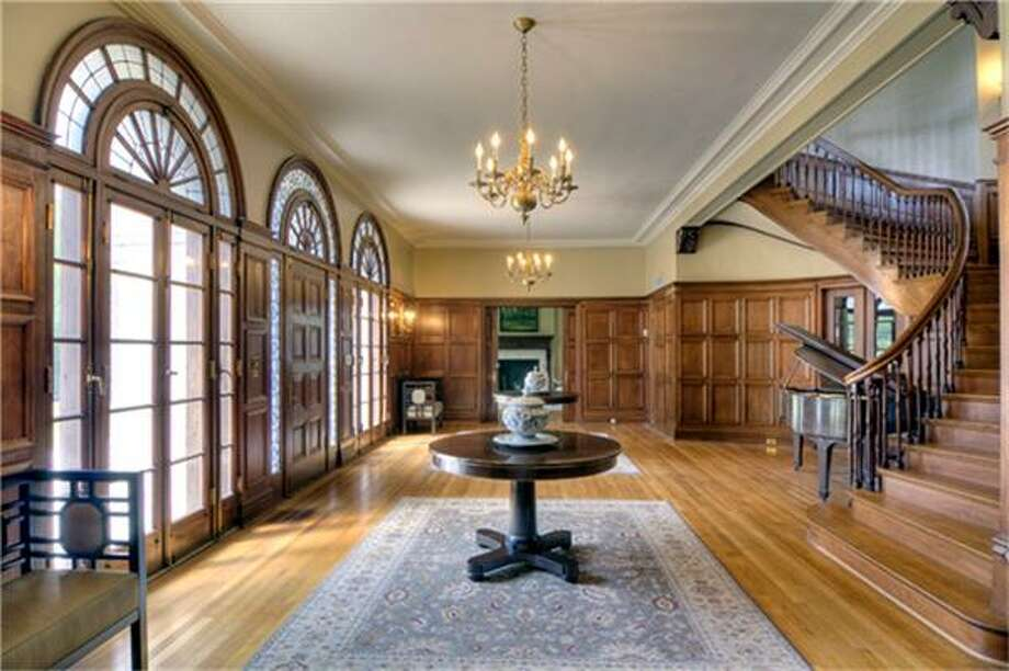 1 Longfellow Lane: This 1926 mega home has 5 bedrooms, 4.5 bathrooms, 7,751 square feet, and features a grand reception hall, Palladian windows, tennis court, cottage with apartment, and a sparkling pool. Listed for $7,599,000. Photo: Houston Association Of Realtors