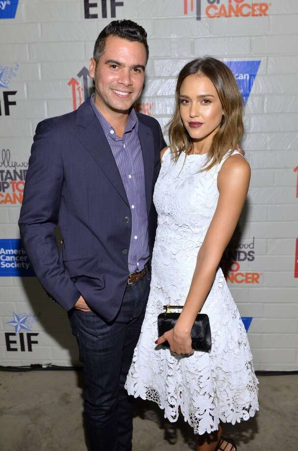 Actress Jessica Alba (R) and producer Cash Warren attend Hollywood Stands Up To Cancer Event with contributors American Cancer Society and Bristol Myers Squibb hosted by Jim Toth and Reese Witherspoon and the Entertainment Industry Foundation on Tuesday, January 28, 2014 in Culver City, California. Photo: Michael Buckner, Getty Images For Entertainment Industry Foundation