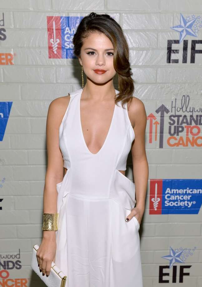 Actress Selena Gomez attends Hollywood Stands Up To Cancer Event with contributors American Cancer Society and Bristol Myers Squibb hosted by Jim Toth and Reese Witherspoon and the Entertainment Industry Foundation on Tuesday, January 28, 2014 in Culver City, California. Photo: Michael Buckner, Getty Images For Entertainment Industry Foundation