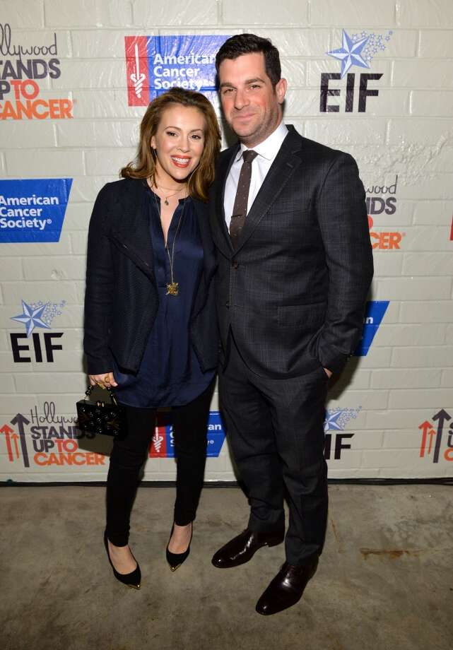Actress Alyssa Milano (L) and David Bugliari attend Hollywood Stands Up To Cancer Event with contributors American Cancer Society and Bristol Myers Squibb hosted by Jim Toth and Reese Witherspoon and the Entertainment Industry Foundation on Tuesday, January 28, 2014 in Culver City, California. Photo: Michael Buckner, Getty Images For Entertainment Industry Foundation