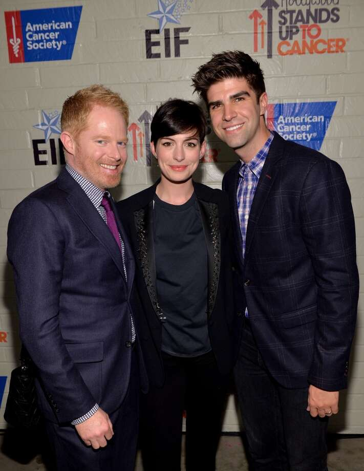 (L-R) Actors Jesse Tyler Ferguson and Anne Hathaway and Justin Mikita attend Hollywood Stands Up To Cancer Event with contributors American Cancer Society and Bristol Myers Squibb hosted by Jim Toth and Reese Witherspoon and the Entertainment Industry Foundation on Tuesday, January 28, 2014 in Culver City, California. Photo: Michael Buckner, Getty Images For Entertainment Industry Foundation