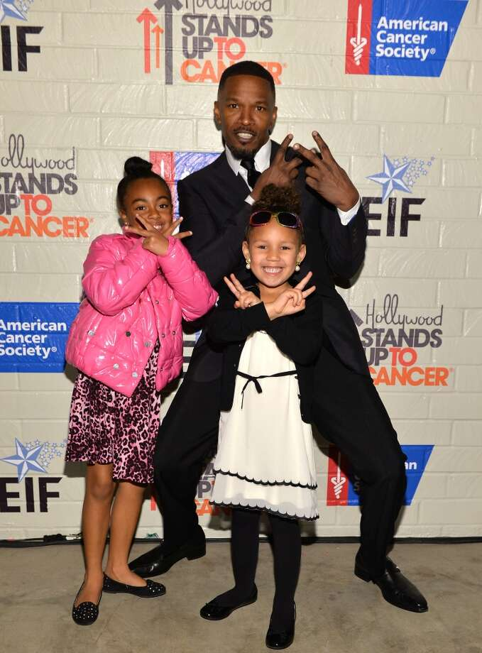 Actor Jamie Foxx (R), Annalise Bishop and guest attend Hollywood Stands Up To Cancer Event with contributors American Cancer Society and Bristol Myers Squibb hosted by Jim Toth and Reese Witherspoon and the Entertainment Industry Foundation on Tuesday, January 28, 2014 in Culver City, California. Photo: Michael Buckner, Getty Images For Entertainment Industry Foundation