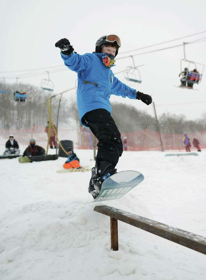 Brendan Fox, 12, of Brewster, N.Y., slidess on a rail in the freestyle area at Thunder Ridge Ski Area in Patterson, N.Y. on Saturday, Jan. 25, 2014.  The mountain, about 20 minutes from Danbury and 80 minutes from New York City, specializes in lessons for people learning to ski and snowboard. Photo: Tyler Sizemore / The News-Times