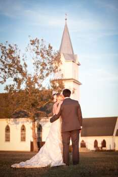"Reader Amy Vercher submitted this photo from her wedding: ""My husband's grandparents were married in New Ulm, Texas, about an hour west of Houston and we decided to get married in the same little country chapel this past November (11/29/13). The church is the Trinity Lutheran Church of Frelsburg and is a historical landmark of Texas. ""