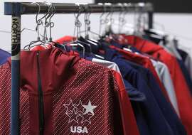 Uniforms designed for the U.S. Olympic freeskiing team hang from a rack at the North Face development center in San Leandro, Calif. The longtime Bay Area outdoor clothing and equipment company is outfitting the U.S. Olympic freeskiing team competing in Sochi, Russia. The limited edition clothing on the racks is available to the public.