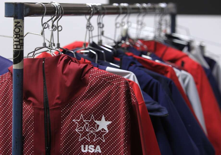 Uniforms designed for the U.S. Olympic freeskiing team hang from a rack at the North Face development center in San Leandro, Calif. The longtime Bay Area outdoor clothing and equipment company is outfitting the U.S. Olympic freeskiing team competing in Sochi, Russia. The limited edition clothing on the racks is available to the public. Photo: Paul Chinn, The Chronicle
