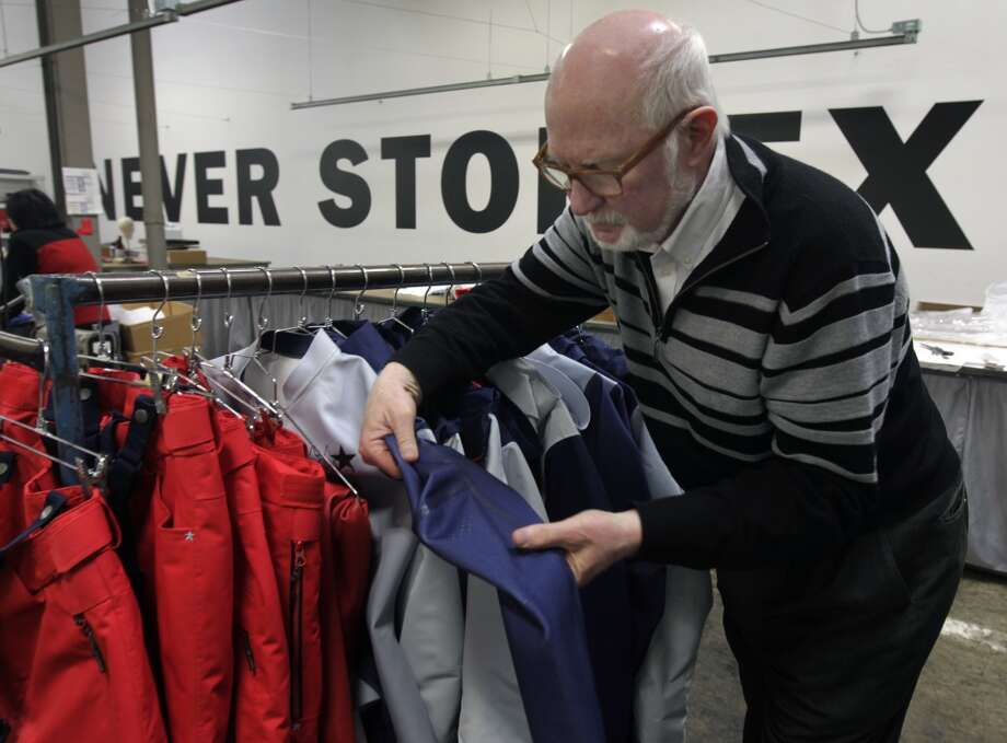 Tom Kelly, an official with the U.S. Ski and Snowboard Association, inspects uniforms designed for the U.S. Olympic freeskiing team at the North Face development center in San Leandro, Calif. The longtime Bay Area outdoor clothing and equipment company is outfitting the U.S. Olympic freeskiing team competing in Sochi, Russia. Photo: Paul Chinn, The Chronicle