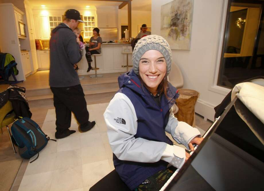 Angeli VanLaanen, a member of the U.S. Freeskiing Team, shows off her piano skills while in her new competition uniform from The North Face. (Photo by Nathan Bilow/Invision for The North Face/AP Images) Photo: Nathan Bilow, Associated Press