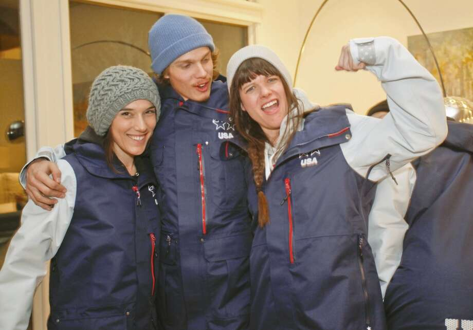 Angeli VanLaanen, left, Lyman Currier, center, and Keri Herman, members of the U.S. Freeskiing Team, check out their new competition uniforms from The North Face, while in Aspen, CO this week preparing for the X-Games. (Photo by Nathan Bilow/Invision for The North Face/AP Images) Photo: Nathan Bilow, Associated Press