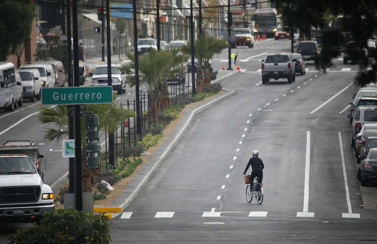 A bicyclist pedals along Cesar Chavez Street at Guerrero Street on Monday, January 27, 2014 in San Francisco, Calif. A ribbon cutting event to mark the completion of the Cesar Chavez Streetscape Project will be held on Wednesday.
