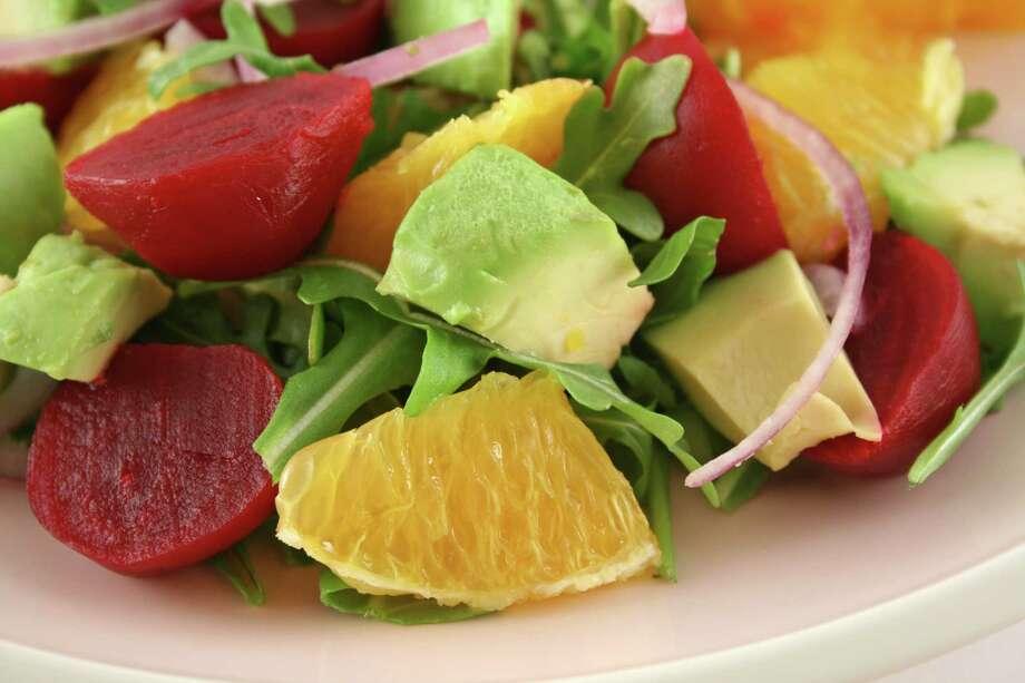 Beetroot avocado and orange salad background. Photo: Brett Mulcahy / Brett Mulcahy - Fotolia