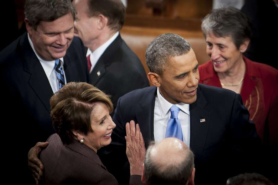 House Minority Leader Nancy Pelosi, D-San Francisco, greets President Obama after Tuesday's address. Photo: Pete Marovich, Bloomberg