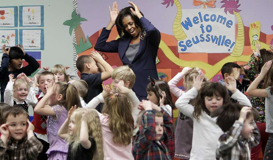 "HOLD FOR RELEASE UNTIL 5 P.M. EST ON WEDNESDAY, JAN. 29, 2014; THIS STORY MAY NOT BE PUBLISHED, BROADCAST OR POSTED ONLINE BEFORE 5 P.M. EST ON WEDNESDAY, JAN. 29, 2014 - FILE - In this Friday, March 9, 2012 file photo, first lady Michelle Obama does a bunny hop dance with pre-schoolers at the Penacook Community Center in Concord, N.H., as part of her Let's Move initiative. A new study published in the New England Journal of Medicine on Wednesday, Jan. 29, 2014 finds that much of a child's ""weight fate"" is set by age 5, and that nearly half of kids who became obese by the eighth grade were already overweight when they started kindergarten. Researchers think there may be a window of opportunity to prevent it, and ""we keep pushing our critical window earlier and earlier on,"" said Solveig Cunningham, a scientist at Emory University. (AP Photo/Jim Cole) Photo: Jim Cole, Associated Press"