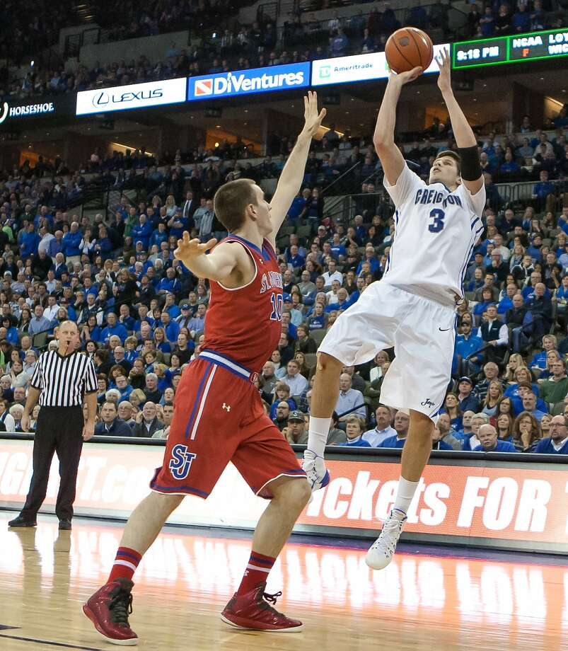 Creighton forward Doug McDermott shoots over St. John's Max Hooper on his way to 39 points. Photo: John Peterson, Associated Press