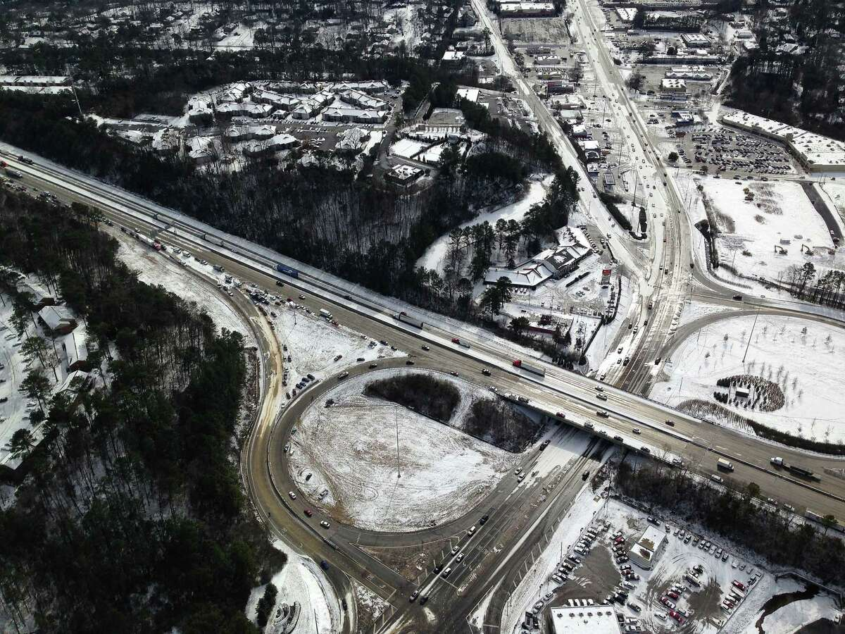 In this aerial view Hoover Ala., vehicles sit on and near the road Wednesday, Jan. 29, 2014, after a winter snow storm swept the area Tuesday. Overnight, the South saw fatal crashes and hundreds of fender-benders. Jackknifed 18-wheelers littered Interstate 65 in central Alabama. Some commuters pleaded for help via cellphones while still holed up in their cars, while others trudged miles home, abandoning their vehicles outright. (AP Photo/Jay Reeves) ORG XMIT: ALJR602