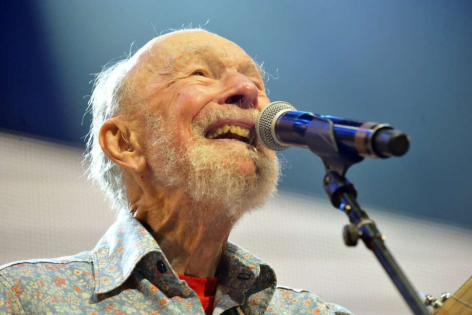 Pete Seeger performs in his usual enthusiastic form last year. Photo: Hans Pennink, Associated Press