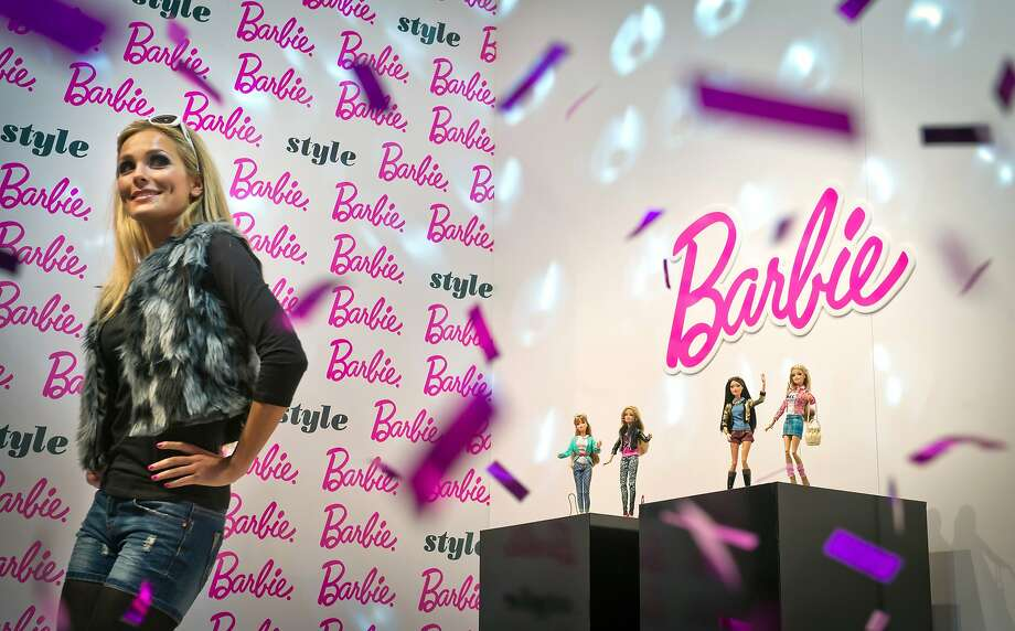 Show and Mattel:A model imitates a Barbie doll during the Runway Show for Barbie Collection 2014 at the Nuremberg International Toy Fair in Nuremberg, Germany. Photo: Joerg Koch, Getty Images