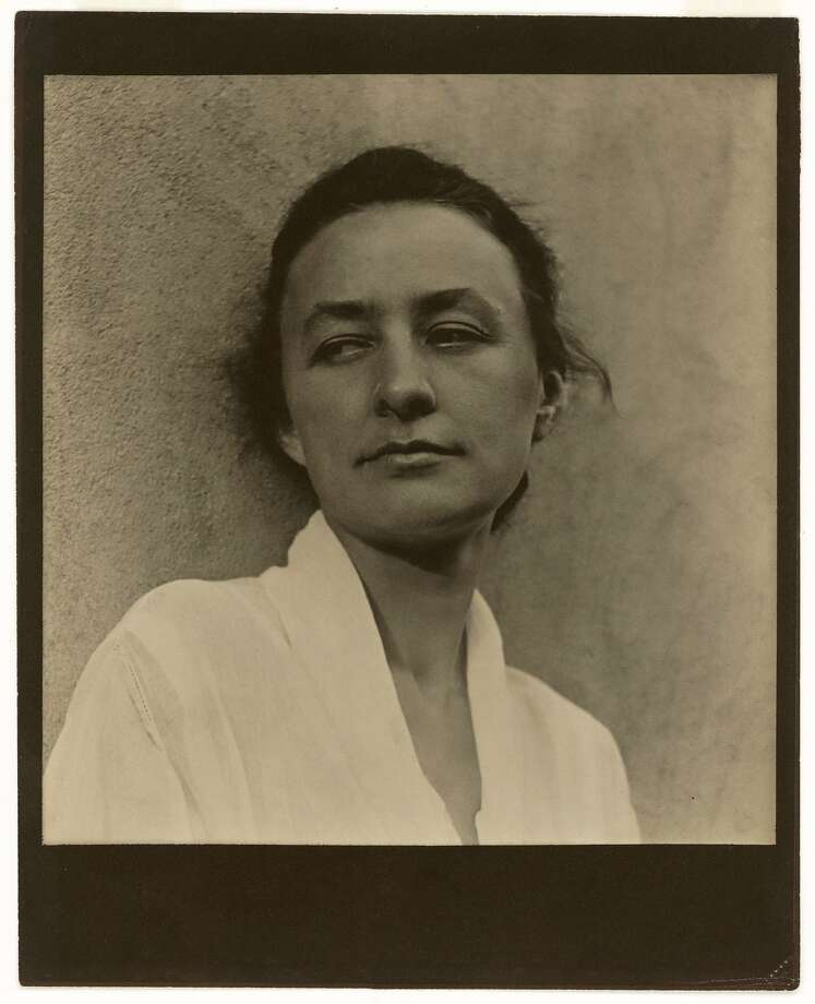 Paul Strand, Georgia O'Keeffe, 1918. Photograph, platinum print. National Portrait Gallery, Smithsonian Institution, Washington, DC. Copyright © Aperture Foundation, Inc., Paul Strand Archive. Photo: Art Resource, NY Georgia O'Keeffe, 1887-1986, Artist. 1918. Photograph, platinum print, 19.9 x 18.9 cm., Photo: Paul Strand, Aperture Foundation Inc.