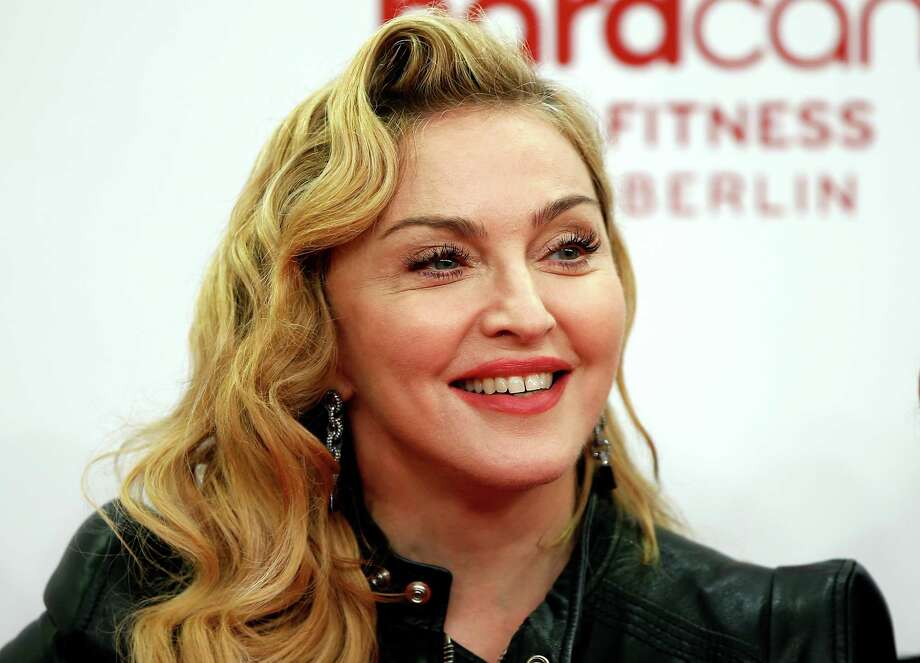 "FILE - In this Thursday, Oct. 17, 2013 file photo, U.S. pop star Madonna smiles during her visit at the ""Hard Candy Fitness"" center in Berlin. It's official: Madonna will perform at the Grammy Awards on Sunday, Jan. 26, 2014. A Friday news release from The Recording Academy had no other details about the seven-time Grammy winner's appearance, however, which has been a rumor for some time.  (AP Photo/Michael Sohn, file) ORG XMIT: CAET385 Photo: Michael Sohn / AP"