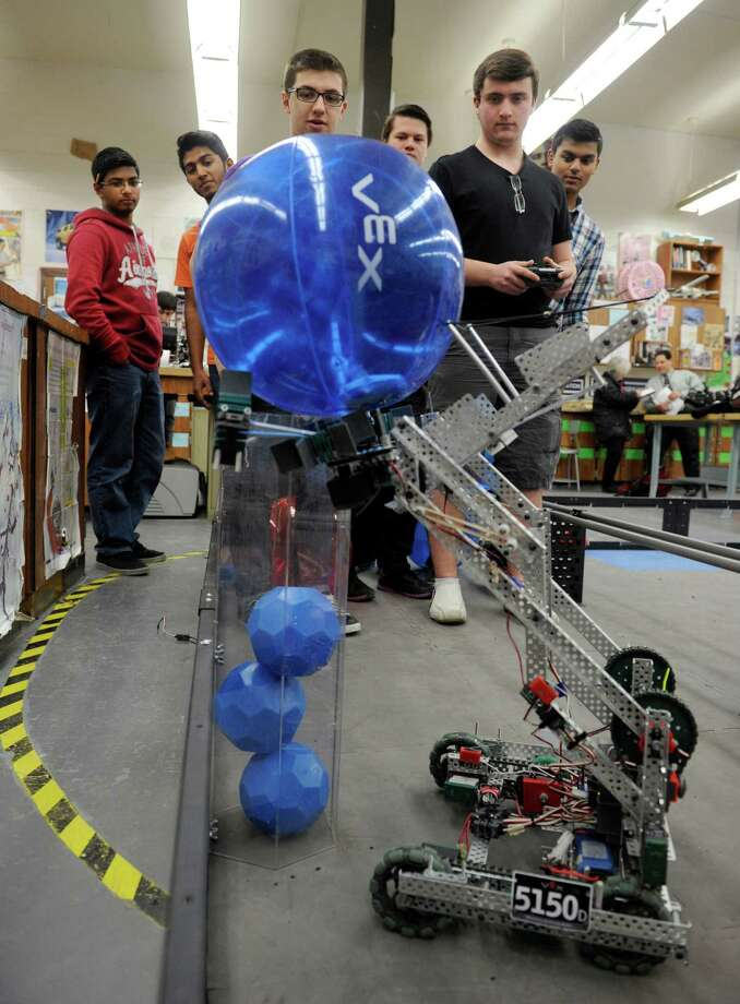 This team of Danbury High School students, demonstrating their 5150D robotics entry, Monday, January 28, 2014, took the top award for excellence in state competition. Photo: Carol Kaliff / The News-Times