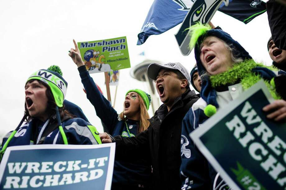 Hundreds of 12th Man fans endured a chilly, wet afternoon at the Seahawks Super Bowl Rally Wednesday, Jan. 29, 2014, on the Seattle Center grounds in Seattle. Mayor Ed Murray, former  Seahawks players, Blitz, the Sea Gals and the Blue Thunder band made an appearance in addition to a live performance by the top 40 cover band, Curb Appeal. Photo: JORDAN STEAD, SEATTLEPI.COM / SEATTLEPI.COM