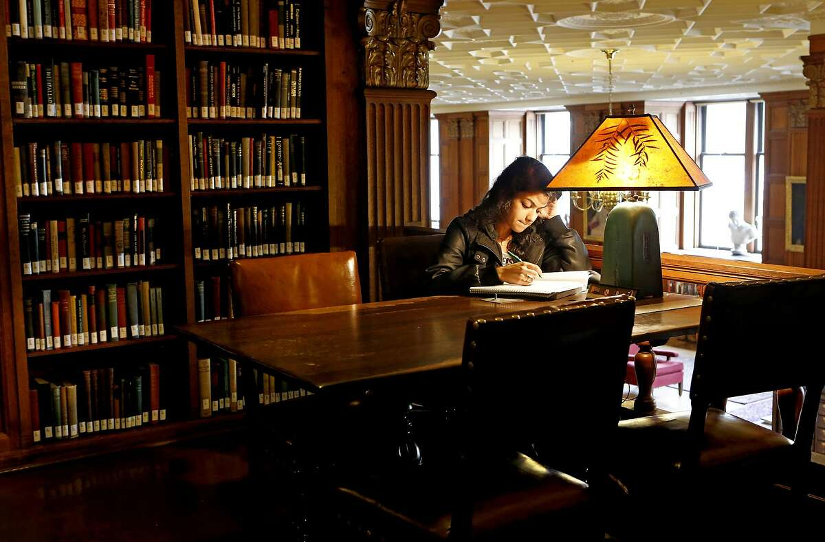 UC Berkeley freshman Urvashi Betarbet studies in the A.F. Morrison Memorial Library, which is within the Doe Library.